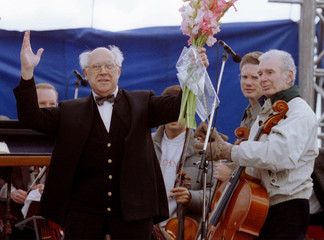 Russian emigre musitian Mstislav Rostropovich waves to the crowd of admirers before the concert on S..