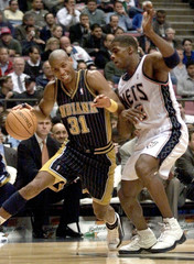 PACERS MILLER TRIES TO PUSH PAST NETS GILL IN EAST RUTHERFORD.