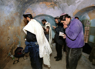"""Jewish settlers pray early December 31 in an Arab home in the """"Casbah""""  in a bid  to expand their pr.."""