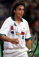 Henri Leconte of France grimaces as he loses a point  during his first round  match of the Paris Ber..