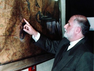 Iranian Vice-President Hassan Habibi looks at the location of Iran on an old islamic map in the natu..