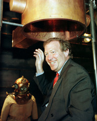 German Economic Minister Gunter Rexrodt pull out the video divers helmet during his visit to the Ger..