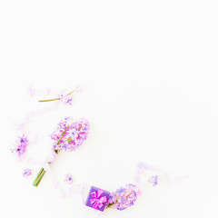 Bouquet of pink hyacinth flowers, ring box and tapes on white background. Flat lay, top view.