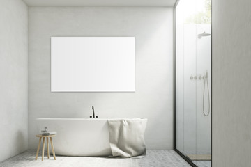 White bathroom with a tub and poster