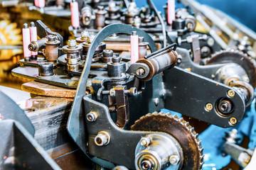 The mechanism of a braiding machine close-up.