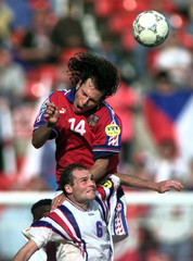 Vincent Guerin of France (bottom) struggles with Patrick Berger to head the ball in their semi-final..