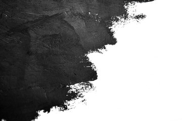 black brush strokes oil paints on white paper. Isolated on white background. Abstract creative...