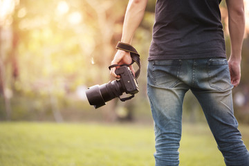 Man is a professional photographer with dslr camera, outdoor and sunlight, Portrait, copy space.