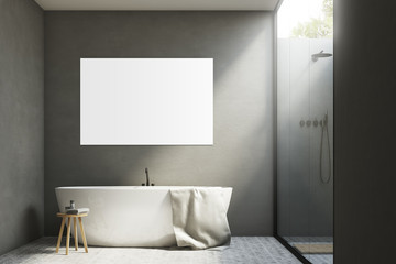 Gray bathroom with a tub and poster