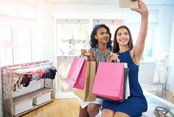 Two attractive female shoppers taking a selfie