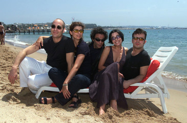 DIRECTOR JEAN MARC BARR WITH ACTERS ON BEACH AT CANNES.