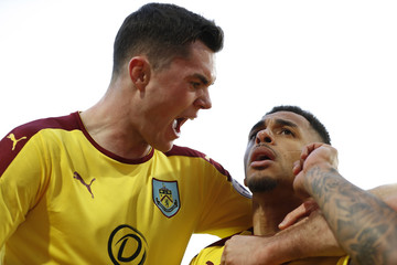 Burnley's Andre Gray celebrates scoring their second goal with Michael Keane