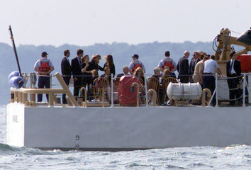 KENNEDY FAMILY RIDES TO USS BRISCOE EN ROUTE TO BURY PLANE CRASH VICTIMS.