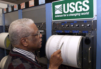 Waverly Person, chief of the United States Geological Service National Earthquake Service studies a ..