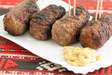 Wall Mural - meat rolls romanian mici mititei with mustard