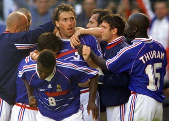 France's Laurent Blanc (5) celebrates his goal with teammates including Marcel Desailly (8) and Lili..