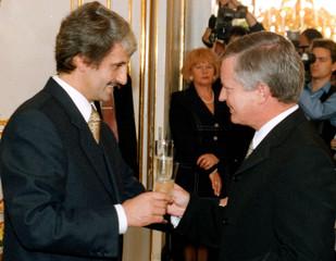 NEW SLOVAK PM DZURINDA TOASTS WITH PARLIAMENTARY CHAIRMAN IN BRATISLAVA.