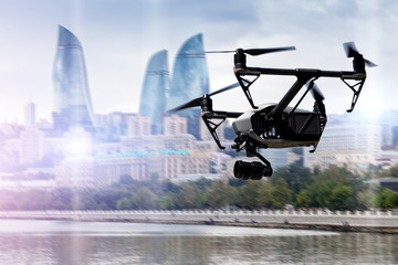 Drone flying over Baku city on blurred background.