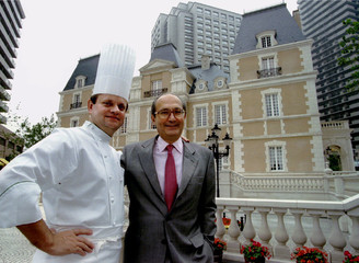 Joel Robuchon (L) chef and owner of the Robuchon Restaurant in Paris and Jean-Claude Vrinat owner of..