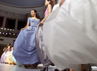 CONTESTANTS IN EVENING DRESSES PERFORM IN BEIJING.