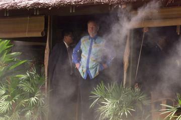 CANADIAN PM CHRETIEN LOOKS OUT FROM HUT IN CYBERJAYA.