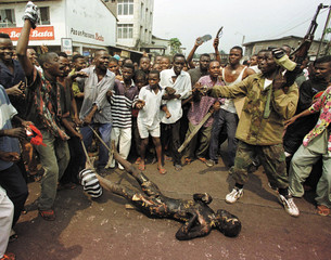 FILE PHOTO - A MAN IS DRAGGED THROUGH THE STREETS OF KINSHASA.
