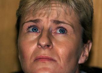 Monika Boettcher, former Monica Weimar, gazes upward in a Frankfurt criminal court on September 2 as..