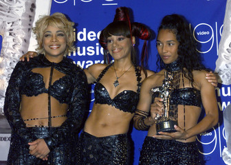 "The group TLC poses with their trophy for ""Best Group Video"" backstage during the 1999 MTV Video Mus.."
