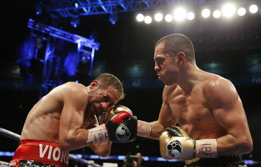 Scott Quigg in action with Viorel Simion