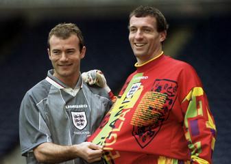 England striker Alan Shearer (L) and goalkeeper Tim Flowers show off the new England shirt at Ewood ..