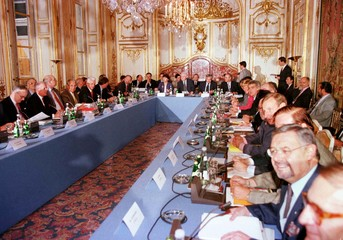 French Prime Minister Lionel Jospin seated at the head of table (rear)  opens of a one-day conferenc..