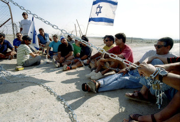 Israeli settlers from the settlement of Naama outside Jericho chain themselves June 13 morning to th..