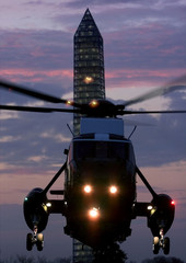 With the Washington Monument in the background, Marine One, the helicopter of U.S. President Bill Cl..