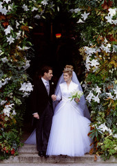 Viscount Linley and Serena Stanhope pause under a floral arch as they leave St Margaret's Church, We..