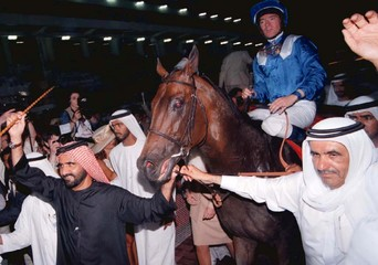 SHEIKH MOHAMED LEADS VICTORIOUS HORSE IN DUBAI.