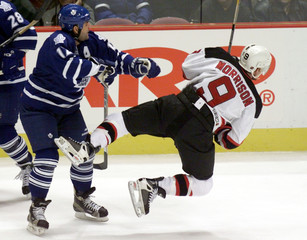 MAPLE LEAFS KING SHOVES DEVILS MORRISON TO ICE IN NHL GAME.
