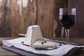 Goat cheese with glass of red wine