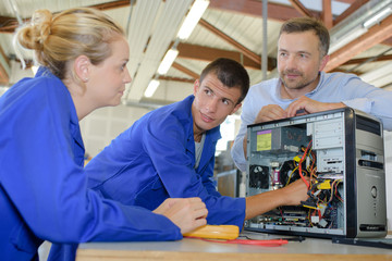 Technicians examining computer