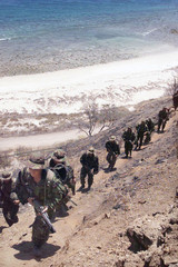 BRITISH GURKHAS WALK UP A HILL DURING MILITARY EXERCISES IN DILI.