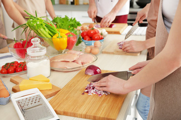 People cutting onion at cooking classes