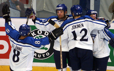 FINNISH PLAYERS CELEBRATE AGAINST SWEDEN.