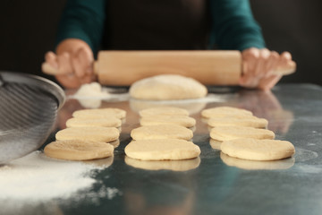 Fresh dough for cookies and woman on background