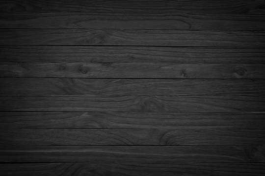 Old black wood. Blackboard. Dark background/ Grunge   gloomy wooden texture
