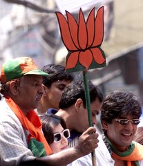 BJP ACTIVISTS CARRY THE PARTY'S ELECTION SYMBOL IN NEW DELHI.