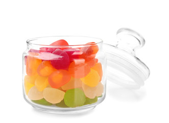 Fototapete - Vase with tasty jelly candies on white background