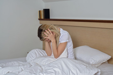 Sleep Disorders, insomnia. Woman Suffering From Depression Sitting On Bed In Pajamas