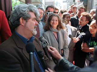 STAR WARS DIRECTOR LUCAS TALKS TO PRESS AT BENEFIT PREMIERE.
