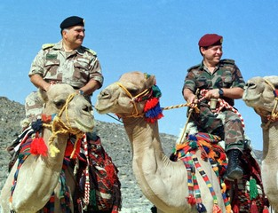AUGUST 1998 FILE PHOTO OF CROWN PRINCE HASSAN AND PRINCE ABDULLAH RIDING CAMELS.