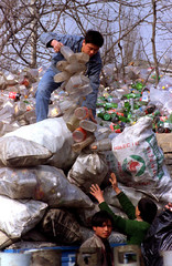 Workers load plastic waste onto a truck at a recycling plant in eastern Beijing March 1. Recycling p..