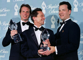 Actors Bill Paxton (L) and Tom Hanks (R) pose with producer Brain Grazier holding the People's Choic..